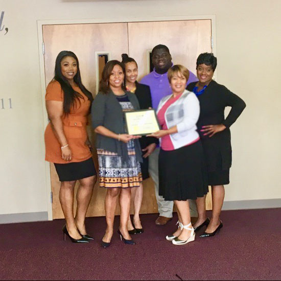 Morrow campus staff are awarded the Member of the Week award by Monica Colbert, President of the Chamber