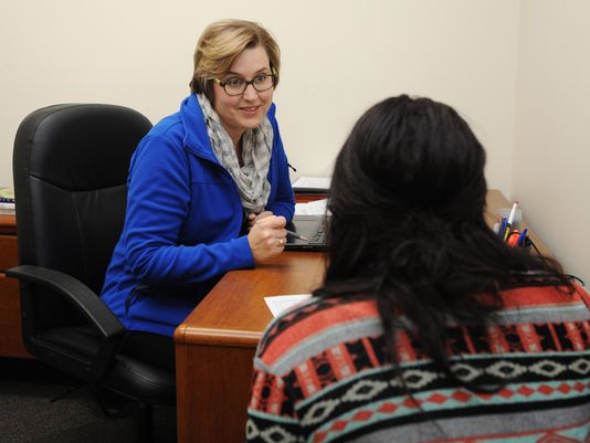 Valerie Jones, left, talks with student Mackenzie Walton in her office Tuesday at Ohio Christian University. Jones, a former Southeastern English teacher, is now the department chair for the teacher education program at Ohio Christian University.