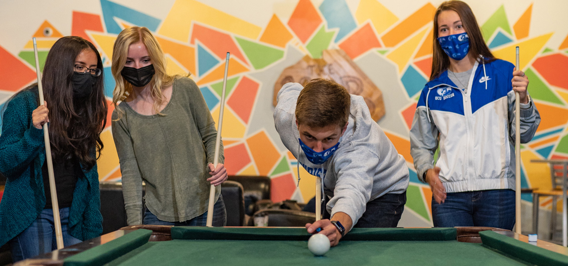 Stundents Wearing Masks and Playing Pool on Campus